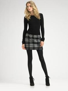 black, narrow-cut sweater, gray miniskirt made of checked wool