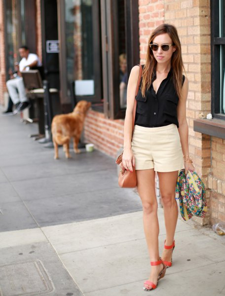black sleeveless shirt with buttons and light yellow mini summer shorts