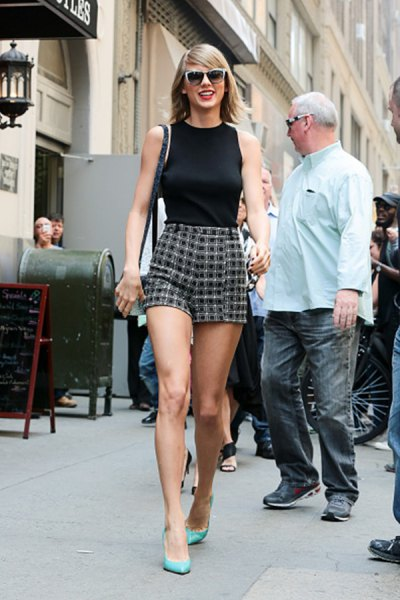black sleeveless top with round neckline and checkered mini-shorts