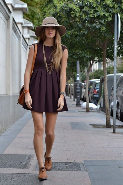 black sleeveless, fuzzy mini dress with brown oxford shoes