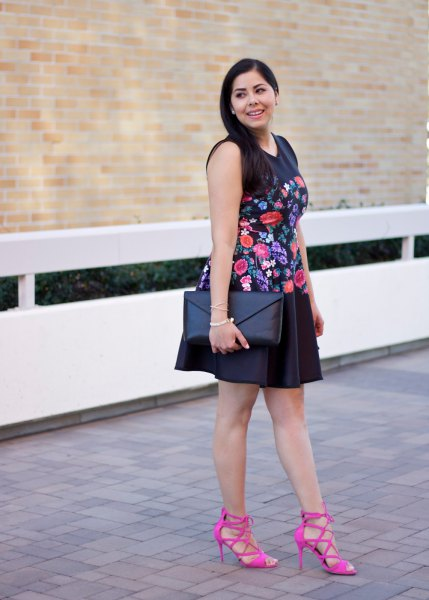 black sleeveless mini swing dress embroidered with flowers with pink strappy heels