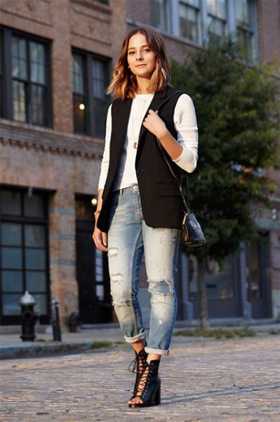black sleeveless jacket with white long-sleeved T-shirt and boyfriend jeans with cuffs
