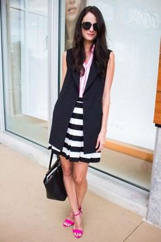 black sleeveless longline blazer with a striped mini skirt and open toe heels