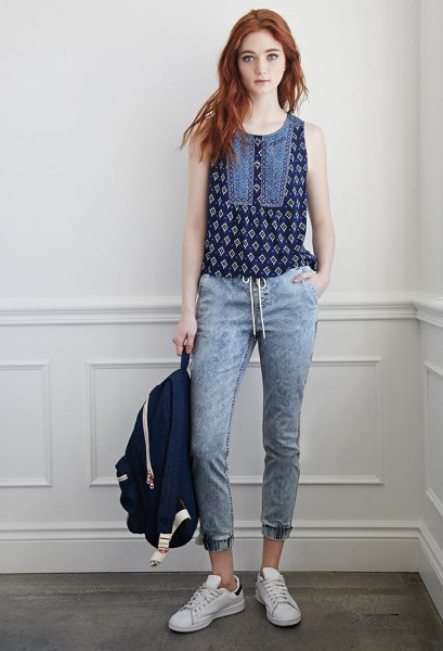 black sleeveless printed top with gray-blue, short-cut jogger jeans