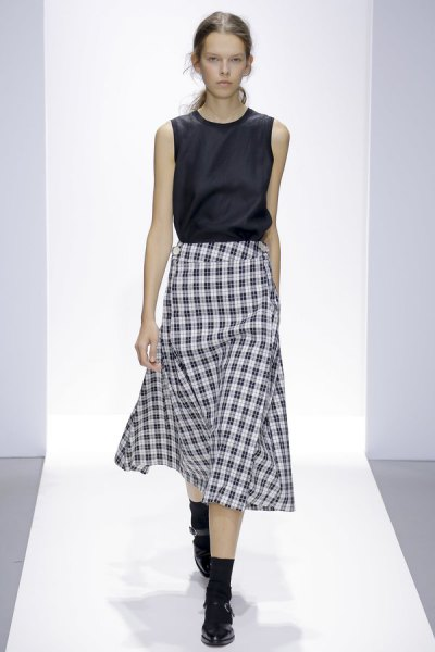 black sleeveless silk top with checked midi skirt