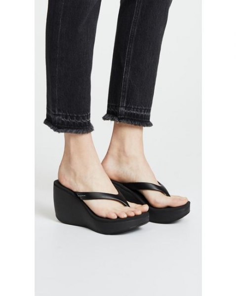 black slim fit jeans with matching flip flops