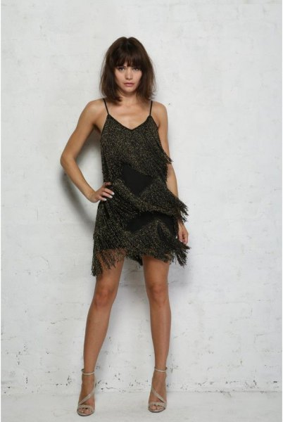 black slip dress with pearl fringes