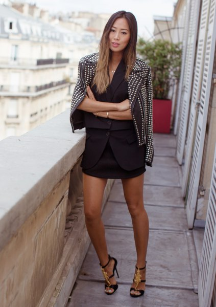 black biker jacket with spikes and mini skirt