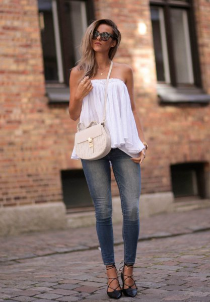black strappy heels on the shoulder blouse skinny jeans