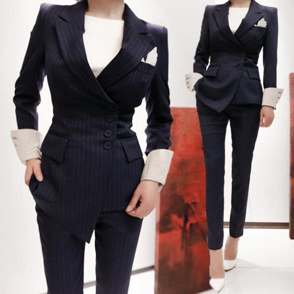 black striped wrap suit with light yellow buttonless blouse