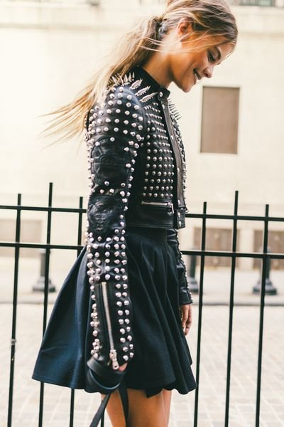 black leather jacket with rivets and minirater skirt