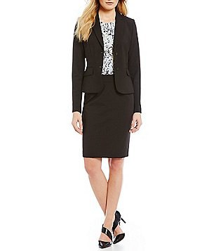 black suit consists of a short coat and pencil skirt