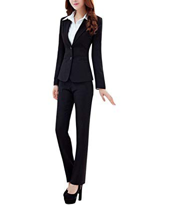 The black suit consists of a slim-fitting blazer and slightly flared trousers