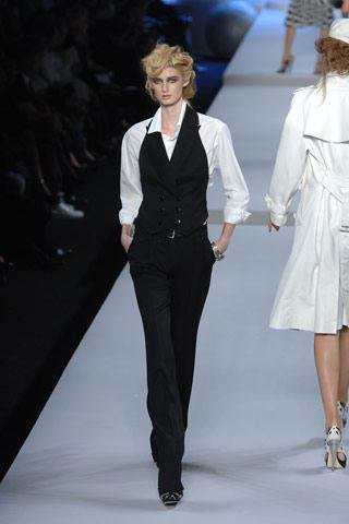 black suit vest with white shirt and suit trousers