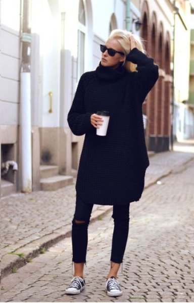 black sweater dress with ripped skinny jeans