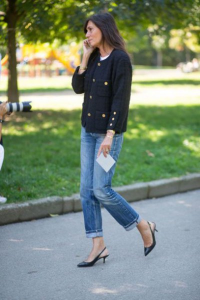 black sweater with blue jeans with cuffs and kitten heels