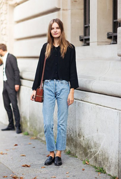 black sweater with blue jeans and leather shoes