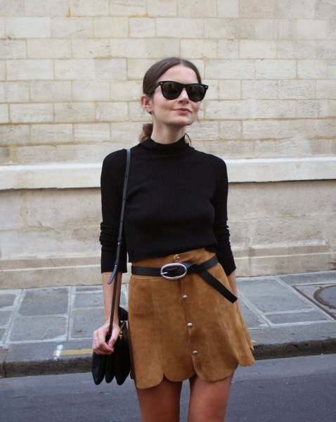 black sweater with brown mini skirt with scalloped hem and belt