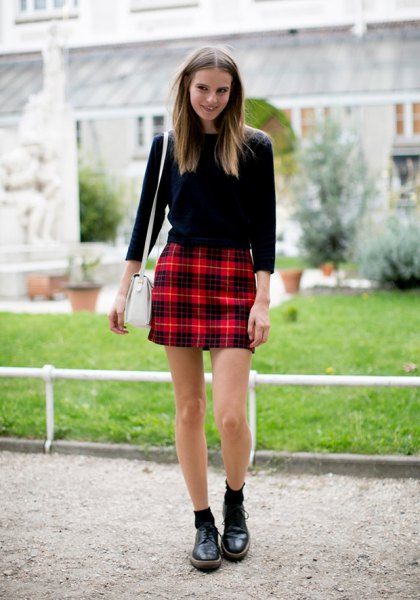 black sweater with red checked high-rise mini skirt