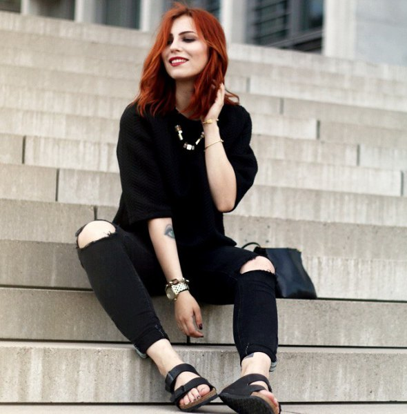 black sweater with knee-torn jeans and slide sandals