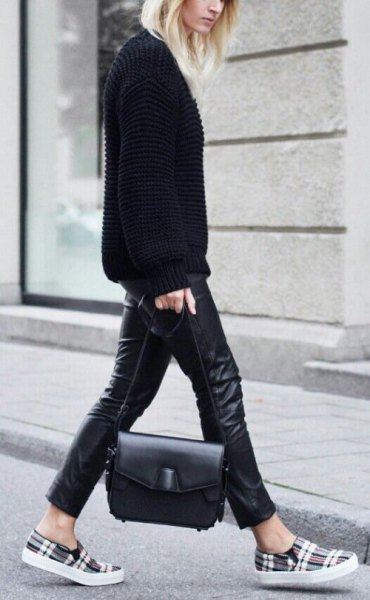 black sweater with leather gaiters and gray checkered shoes