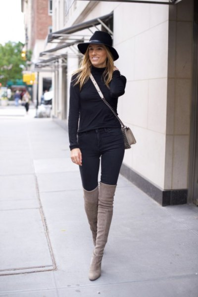 black sweater with matching high jeans and gray overknee boots