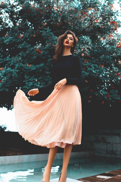 black sweater with light pink chiffon midi pleated skirt