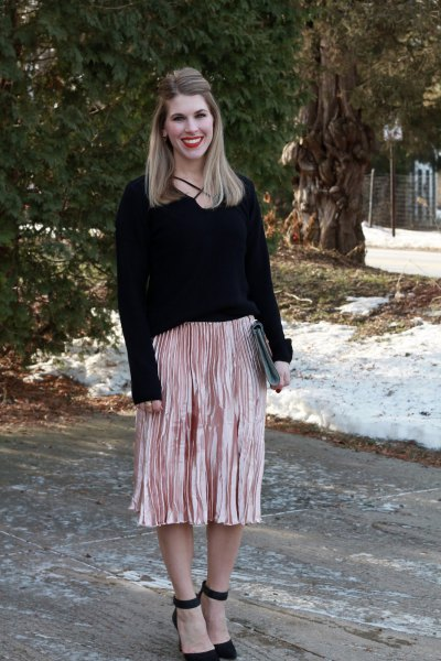 black sweater with rose gold colored midi pleated skirt