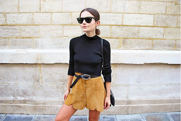 black sweater with mini skirt made of suede with a serrated edge