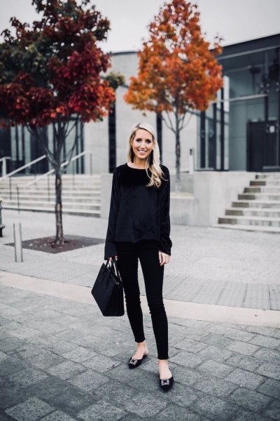 black sweater with skinny jeans and ribbons