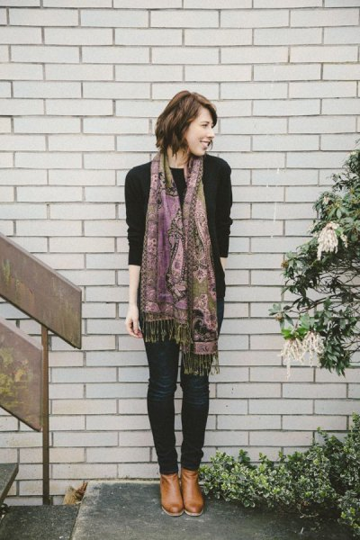 black sweater with pashmina scarf with tribal print and dark skinny jeans