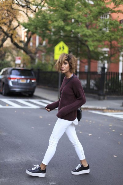 black sweater with white skinny jeans and sneakers