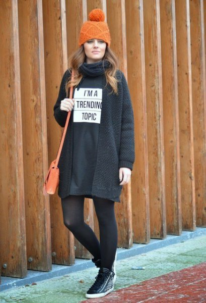 black sweatshirt dress with stockings and hiking boots