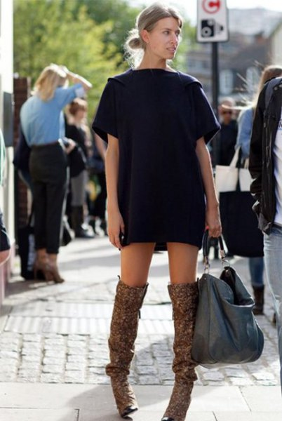 black t-shirt dress with brown long flat boots