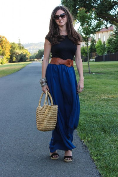 black t-shirt with brown belt and blue maxi skirt