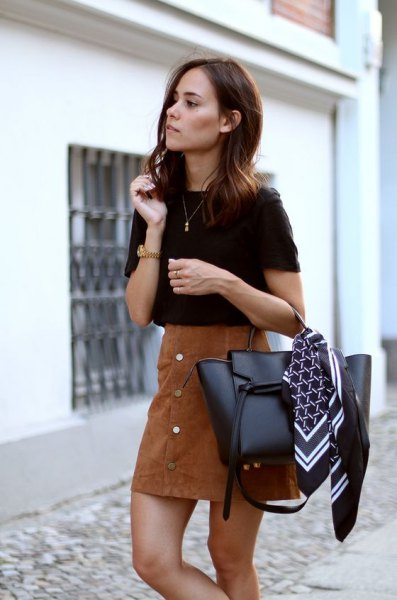 black t-shirt with brown suede button on the front mini skirt