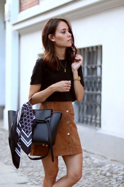 black t-shirt with brown suede skirt