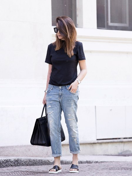 black t-shirt with cuffed jeans and sandals