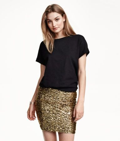 black t-shirt with gold mini skirt