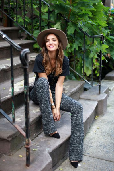 black t-shirt with gray flared pants and heels