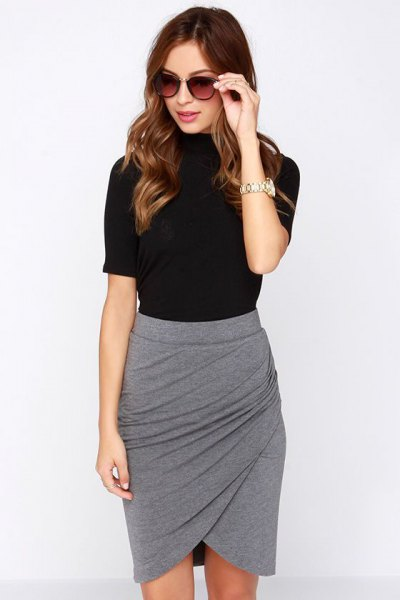 black t-shirt with gray mini skirt