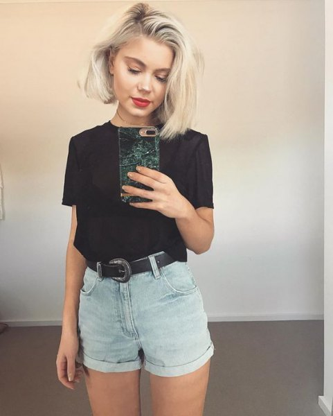 black t-shirt with light blue denim shorts with mini cuffs