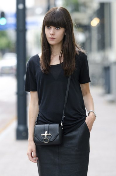black t-shirt with matching figure-hugging knee-length skirt