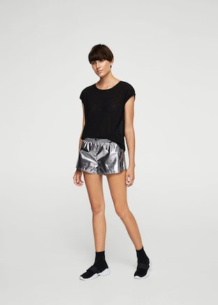 black t-shirt with silver shorts and sneakers
