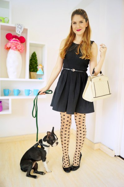 black mini cat dress with tank belt, dotted stockings and ballerinas