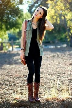 black tank top with matching skinny jeans and lace-up boots in the middle of the calf