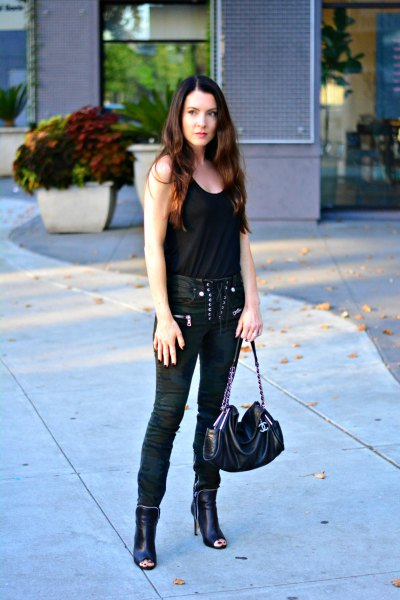 black tank top with moto lace-up pants
