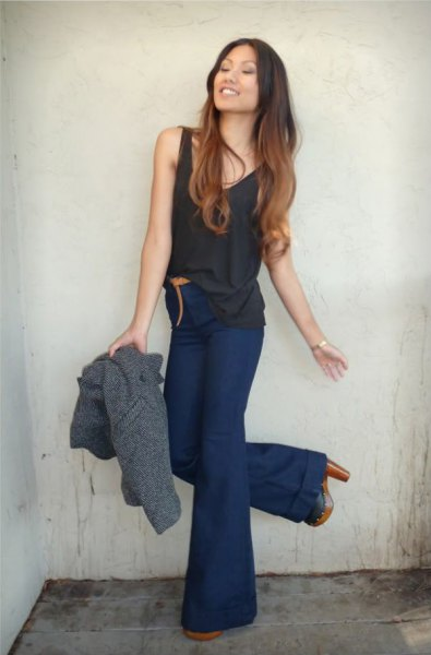 black tank top with dark blue, high-waisted, flared jeans
