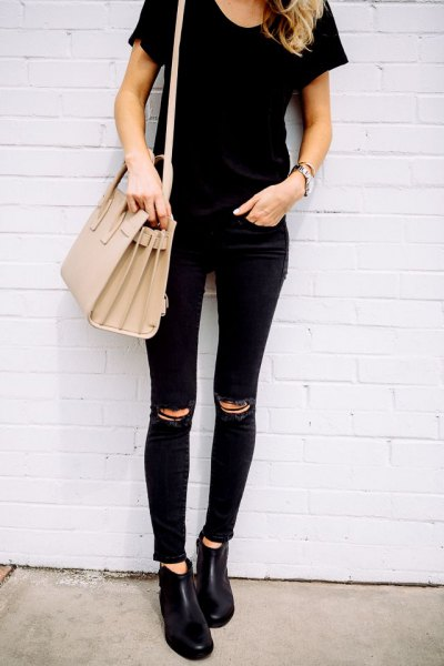 black t-shirt with a torn knee, matches skinny jeans