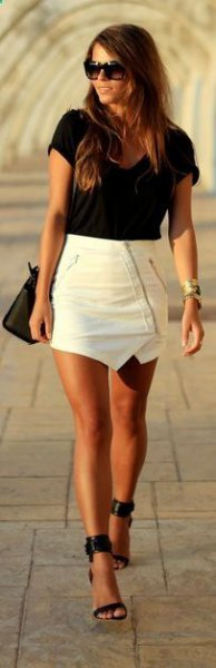 black t-shirt with white leather mini skirt and heels with ankle straps